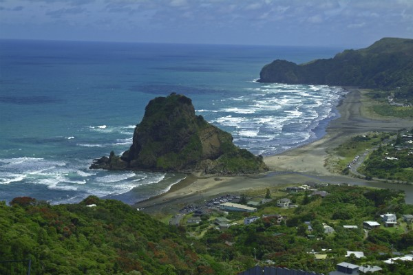 Lion Rock overlooks the surfers of Piha